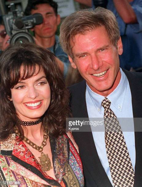 American actor Harrison Ford with actress Sela Ward at the premiere of the film 'The Fugitive' at Mann's Village Theater in Westwood California...