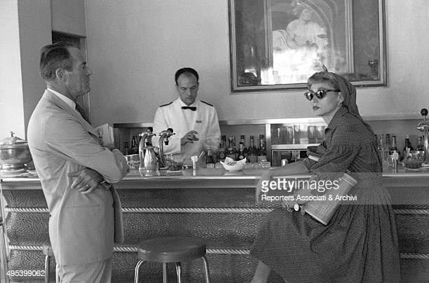 American actor Henry Fonda and his wife Afdera Franchetti at the counter of the Doney bar on via Veneto Rome 1st August 1959