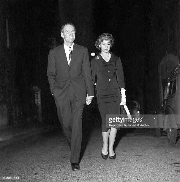American actor Henry Fonda and his wife and Italian baroness Afdera Franchetti walking in the street by night after an opening night at Eliseo...