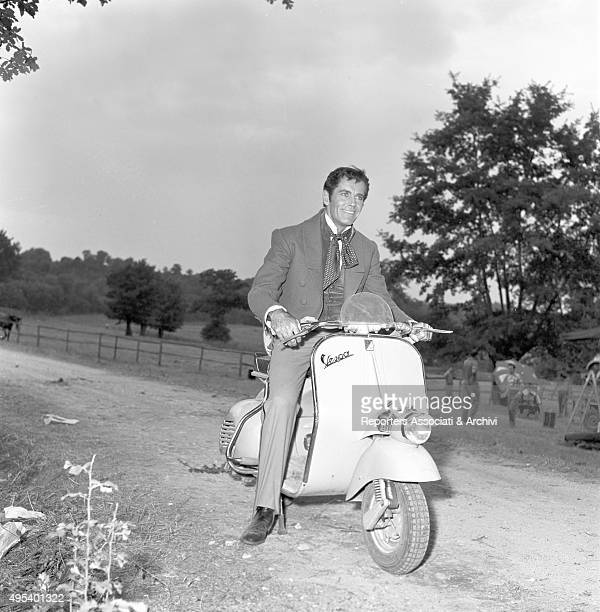 American actor Henry Fonda riding a Vespa in stage costume on the set of the film War and Peace Rome 1955