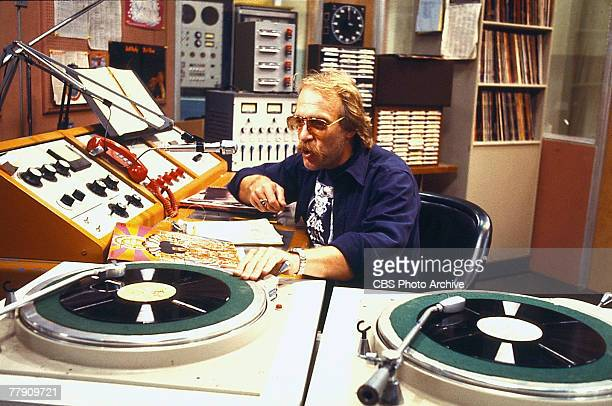 American actor Howard Hesseman talks into a microphone in a broadcast booth in a scene from an unidentified episode of the television comedy 'WKRP in...