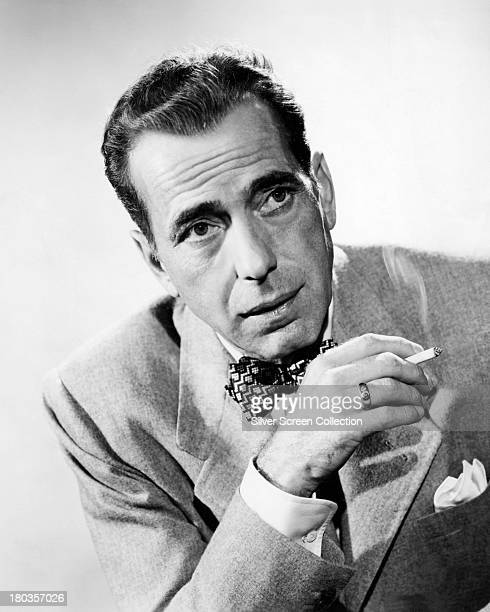 American actor Humphrey Bogart wearing a bow tie and smoking a cigarette circa 1945 Photo by Silver Screen Collection/Getty Images