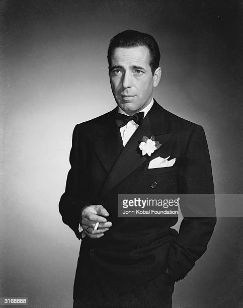 American actor Humphrey Bogart wearing a tuxedo and bow tie.