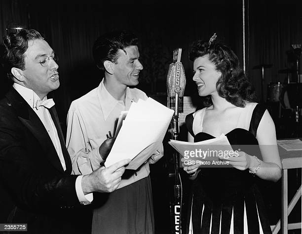 American actor Jack Haley American singer and actor Frank Sinatra and American actor Barbara Hale in a broadcast studio for an episode of the radio...