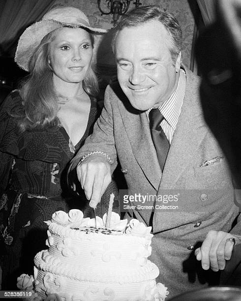 American actor Jack Lemmon cuts the cake at his 50th birthday party at the Plaza Hotel New York City 20th February 1975 On the left is Lemmon's wife...