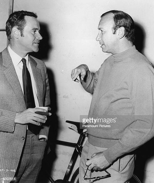 American actor Jack Lemmon listens to American playwright Neil Simon on the set of director Arthur Hiller's film 'The OutofTowners' Lemmon starred in...