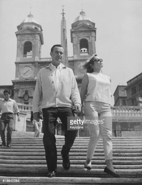 American actor Jack Lemmon with his new wife actress Felicia Farr on the Spanish Steps during a holiday in Rome Italy 1st September 1962