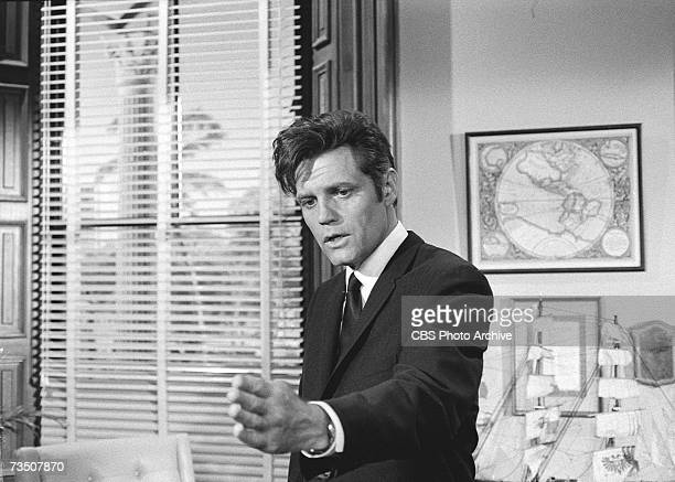 American actor Jack Lord born John Joseph Patrick Ryan speaks and gestures in character as Steve McGarrett during the episode 'Leopard on the Rocks'...