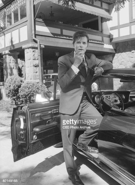 American actor Jack Lord in character as Detective Steve McGarrett speaks on a portable radio in a scene from an episode of the television police...