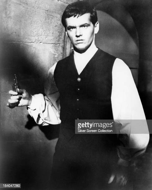 American actor Jack Nicholson holding a pistol, as Andre Duvalier in 'The Terror', directed by Roger Corman, 1963.