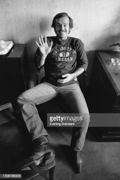 American actor Jack Nicholson waves to the camera whilst seated on a chair, 19th March 1971. Jack Nicholson plays the role of Jonathan Fuerst in the...