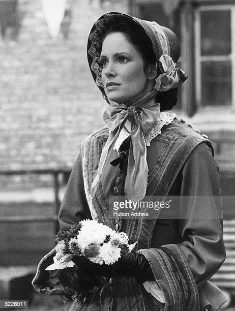 American actor Jaclyn Smith as the title character in a still from the made-for-TV movie 'Florence Nightingale'. Smith is wearing a period costume...