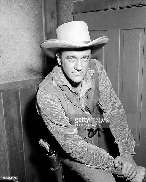 American actor James Arness poses on the set of the TV western 'Gunsmoke' during the taping of the episode titled 'The Killer' May 3 1956