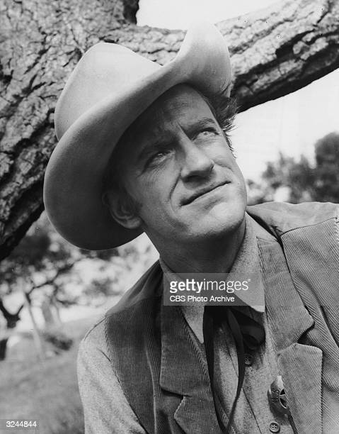 American actor James Arness wears a cowboy hat as Marshal Matt Dillon in a promotional portrait on the television show 'Gunsmoke'