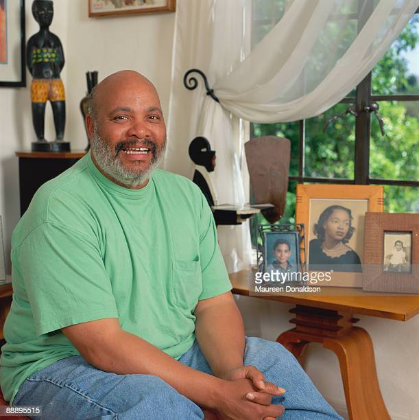 American actor James Avery with some family photographs circa 1995 His bestknown role is that of Uncle Phil in 'The Fresh Prince of BelAir'