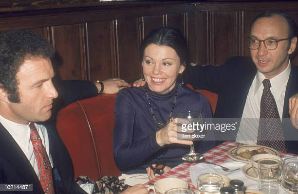 American actor James Caan sits at a table in Gallagher's restaurant with actress Marsha Mason and her husband playwright Neil Simon during the...