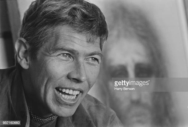 American actor James Coburn 4th May 1966 In the background a drawing of Jesus Christ by American actress and visual artist Kim Novak