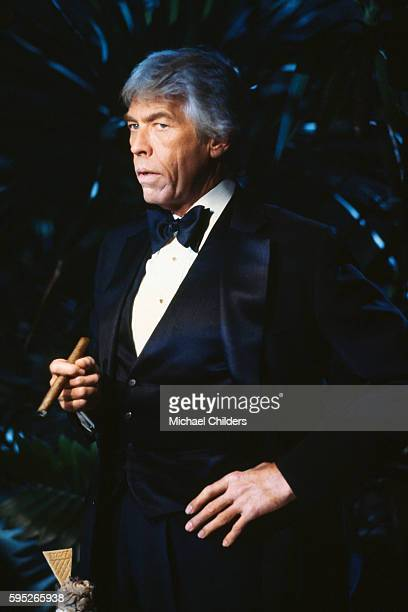 American actor James Coburn on the set of Looker by director screenwriter and producer Michael Crichton
