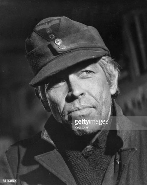 American actor James Coburn plays Sergeant Steiner in the wartime drama 'Cross of Iron' directed by Sam Peckinpah