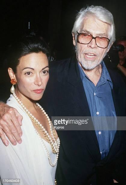 American actor James Coburn with his partner Paula Murad circa 1993