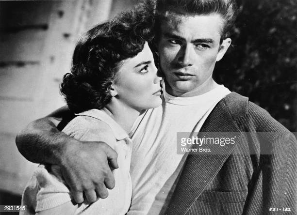 American actor James Dean holds American actor Natalie Wood in a scene from 'Rebel Without A Cause' directed by Nicholas Ray 1955