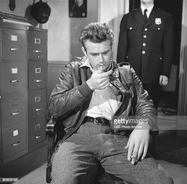 American actor James Dean slumps in a chair in a scene from an episode of the 'Schlitz Playhouse of Stars' entitled 'The Unlighted Road' April 1 1955