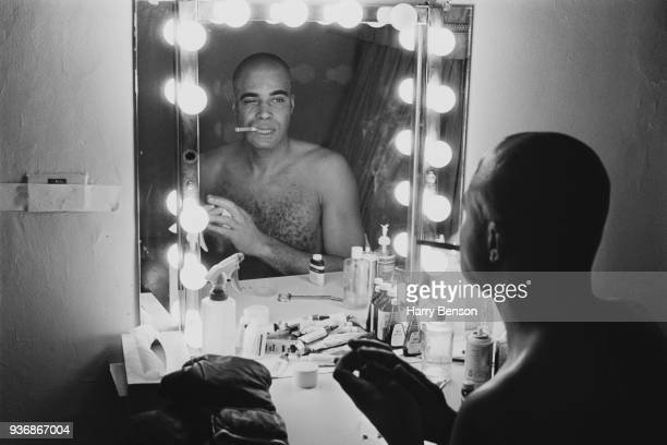 American actor James Earl Jones looking at his reflection in a mirror in a dressing room before going on stage to appear in the play 'The Great White...