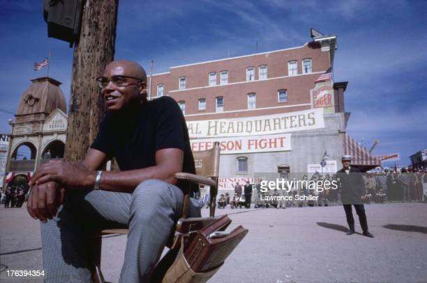 American actor James Earl Jones sits in a chair on an outdoor set during the production of his film 'The Great White Hope' Los Angeles California 1970