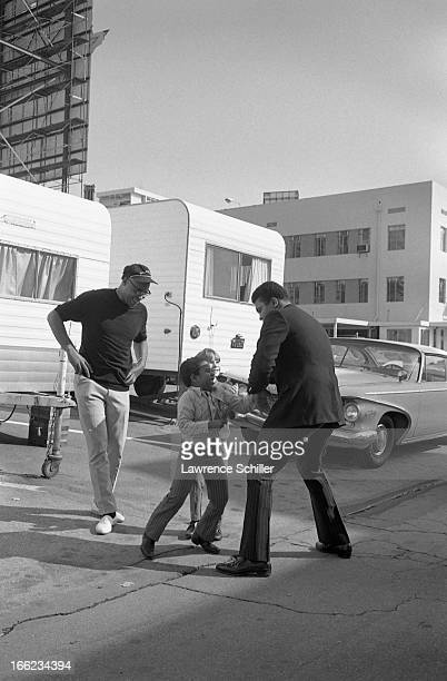 American actor James Earl Jones smiles as he watches boxer Muhammad Ali playspar with two young boys on the 20th Century Fox Studios backlot Los...