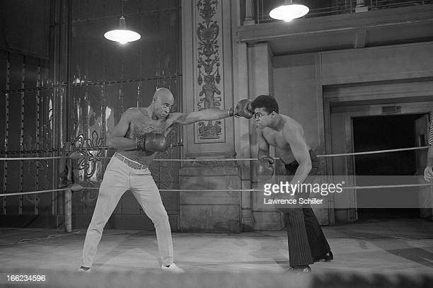 American actor James Earl Jones spars with boxer Muhammad Ali on the set of the film 'The Great White Hope' at 20th Century Fox Studios Los Angeles...