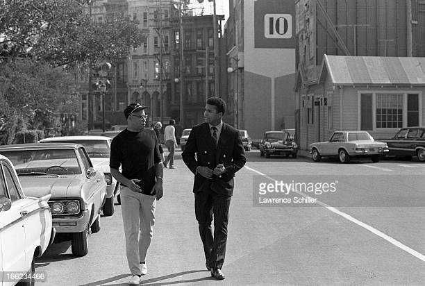 American actor James Earl Jones talks with boxer Muhammad Ali as they walk on the 20th Century Fox Studios backlot Los Angeles California 1968 Ali...