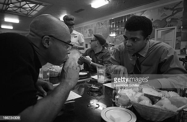 American actor James Earl Jones talks with boxer Muhammad Ali talk as they look over menus in a diner Los Angeles California 1968 Ali was visiting...