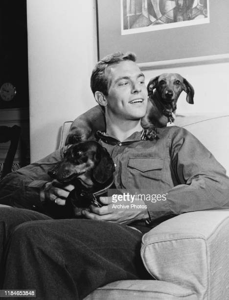 American actor James Franciscus with two dogs circa 1960