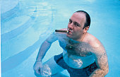 American actor james gandolfini as tony soprano smokes a cigar while picture id50555794?s=170x170