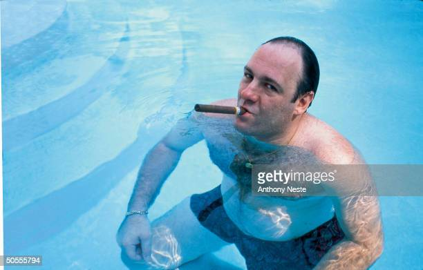 American actor James Gandolfini as Tony Soprano smokes a cigar while he stands in pool in publicity still for the HBO cable TV series 'The Sopranos'...