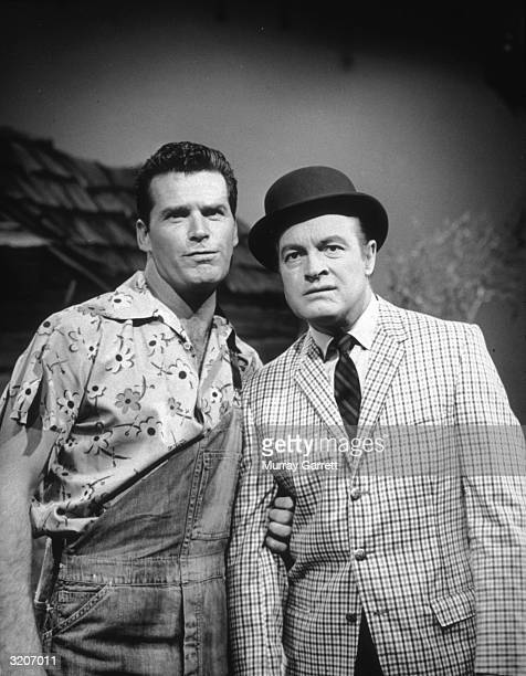 American actor James Garner and British-born comedian and actor Bob Hope pose arm-in-arm in a skit for a Hope television special, Los Angeles,...