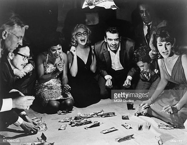 American actor James Garner plays the title role in the dice game scene from 'Mister Buddwing' directed by Delbert Mann 1966 Left to right Wesley...