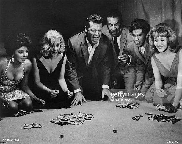 American actor James Garner plays the title role in the dice game scene from 'Mister Buddwing' directed by Delbert Mann 1966 Left to right Nichelle...