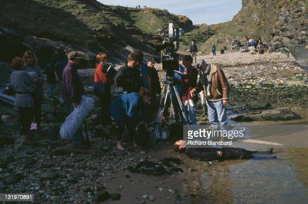 American actor James Spader washes up on an Irish beach in a scene from the film 'Driftwood' 1997