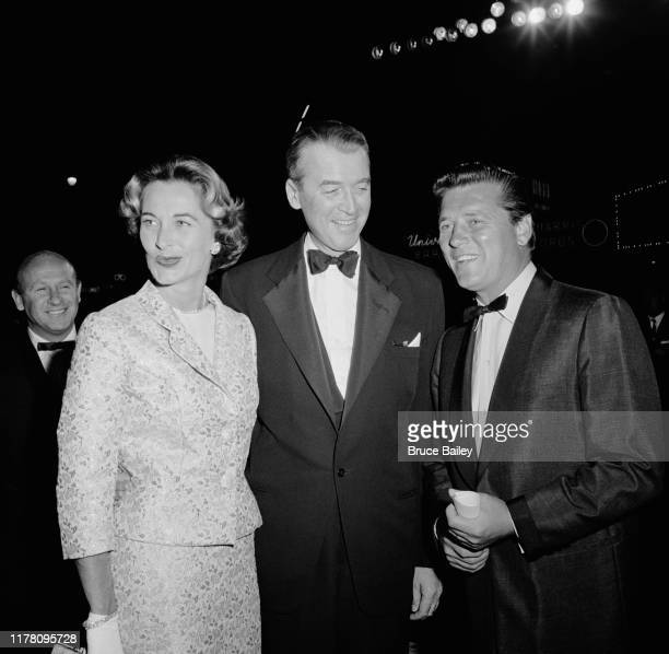 American actor James Stewart and his wife Gloria Hatrick McLean with actor Gordon MacRae at the premiere of the film 'The Spirit of St Louis' at...
