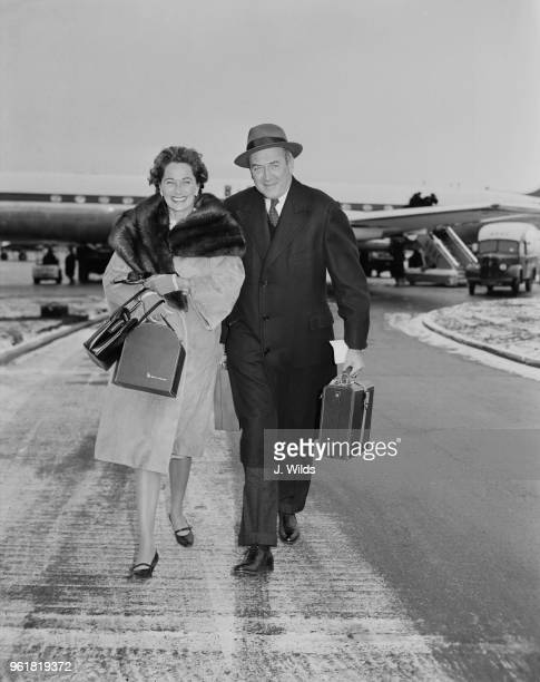 American actor James Stewart arrives at London Airport with his wife actress and model Gloria Hatrick McLean 12th January 1959 They will spend a few...