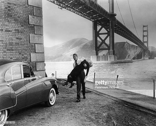 American actor James Stewart as Detective Scottie Ferguson rescues Kim Novak from drowning in a scene from 'Vertigo' directed by Alfred Hitchcock for...