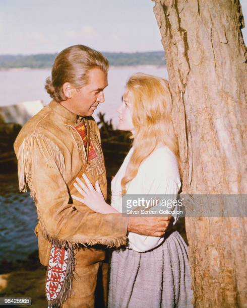 American actor James Stewart as Linus Rawlings and American actress Carroll Baker as Eve Prescott in the film 'How the West Was Won' 1962