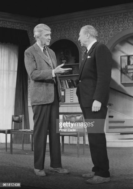 American actor James Stewart discusses his part in the Mary Chase play 'Harvey' with director Anthony Quayle at the Prince of Wales Theatre in London...