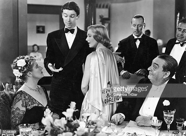 American actor James Stewart introduces American actor Jean Arthur to his mother played by British actor Mary Forbes while Australian actor Robert...