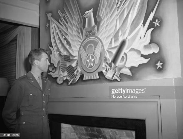 American actor James Stewart looks at the insignia of the 8th Army Air Force at a US air base near London during World War II 2nd December 1943...