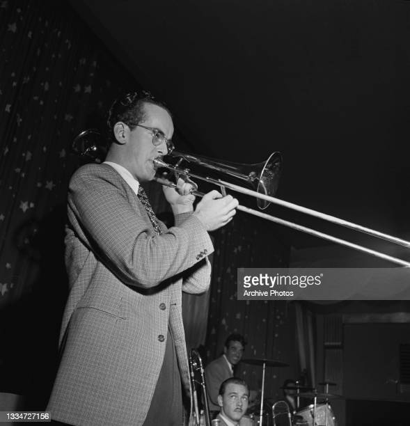 American actor James Stewart with American bandleader and drummer Gene Krupa behind his drum kit in the background, and an unspecified musician, in a...