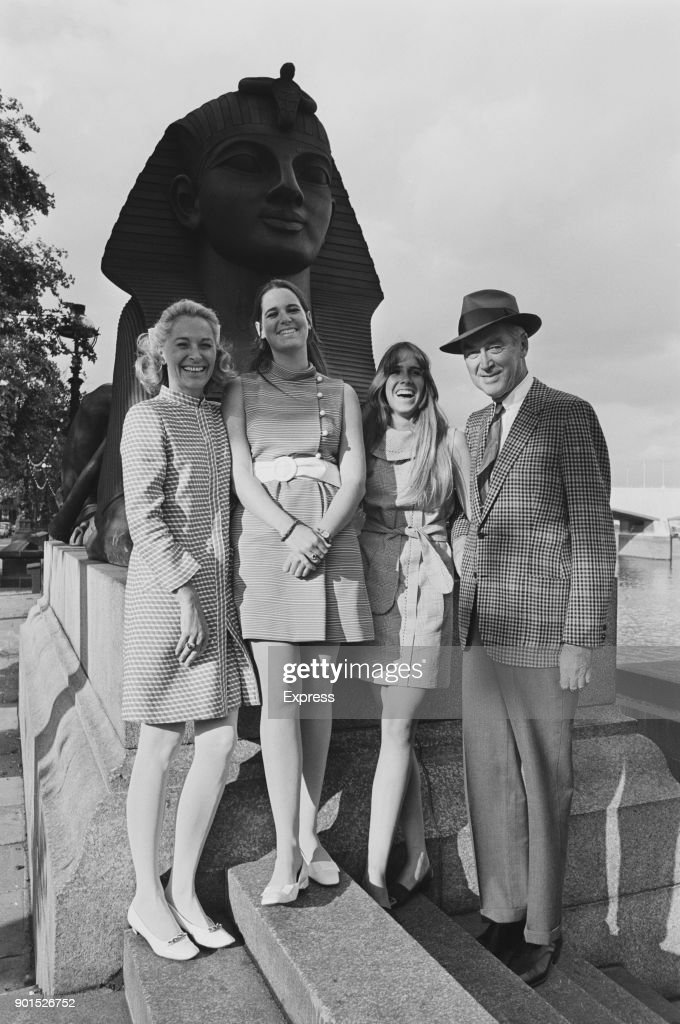 American actor James Stewart (1908 - 1997) with his wife, actress and model Gloria Hatrick McLean (1918 - 1994) and their daughters Judy and Kelly, sightseeing in London, UK, 24th June 1968.