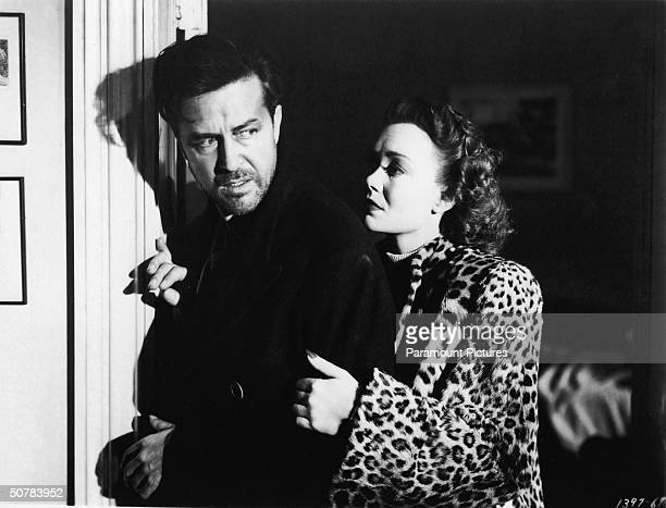 American actor Jane Wyman comforts actor Ray Milland in a still from the film 'The Lost Weekend,' by BIlly Wilder, 1945.