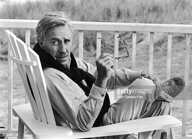1977 American actor Jason Robards sits in an Adirondack chair on a porch in a still from the film 'Julia' directed by Fred Zinnemann
